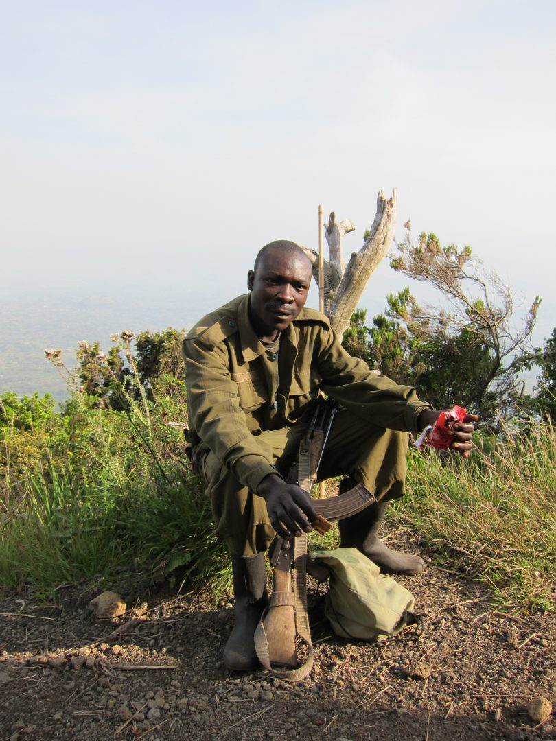 My 'assistant' guide on a hike in Uganda. Supposedly armed in case I encounter any wild buffaloes. Right.
