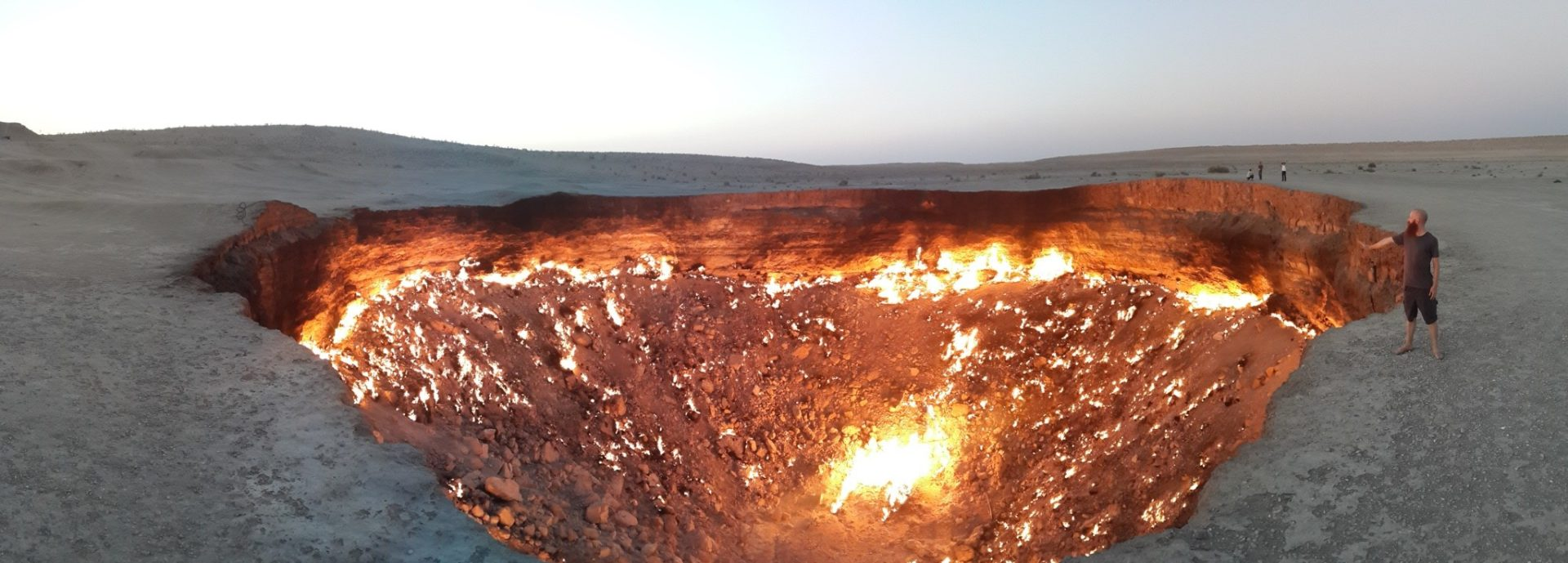 A railing-free, burning gas crater pictured next to a non-Russian-speaking vegetarian in flip-flops in the Karakum desert, Turkmenistan.